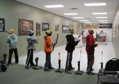 Young archers shooting in our indoor archery range