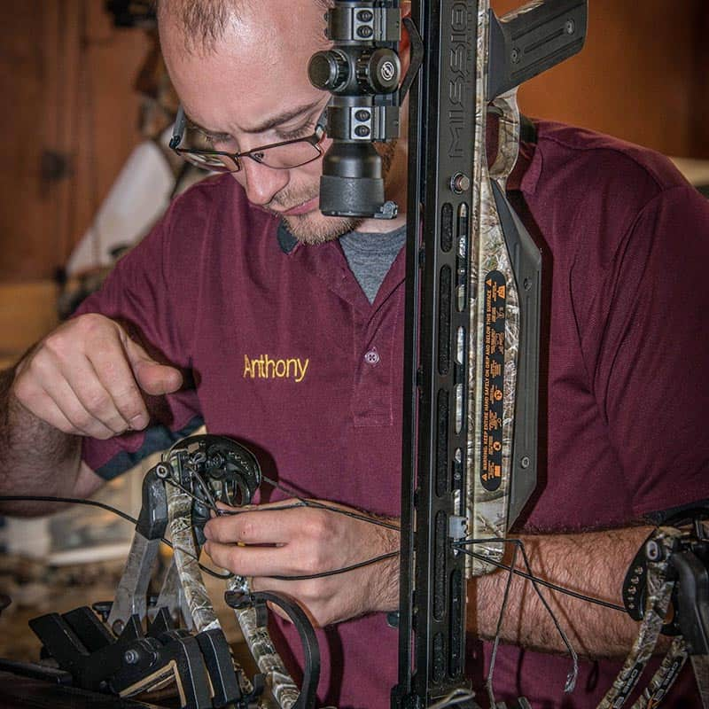 Anthony repairing a crossbow